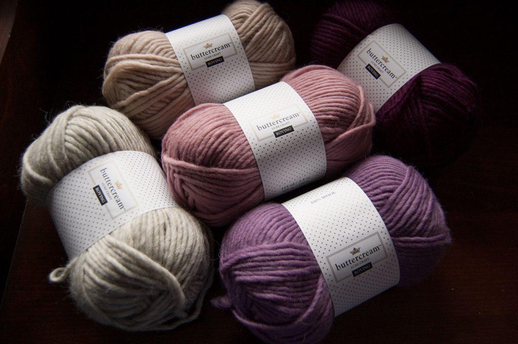 Joann store's Buttercream Luxe Craft Roving yarn in multiple colorways