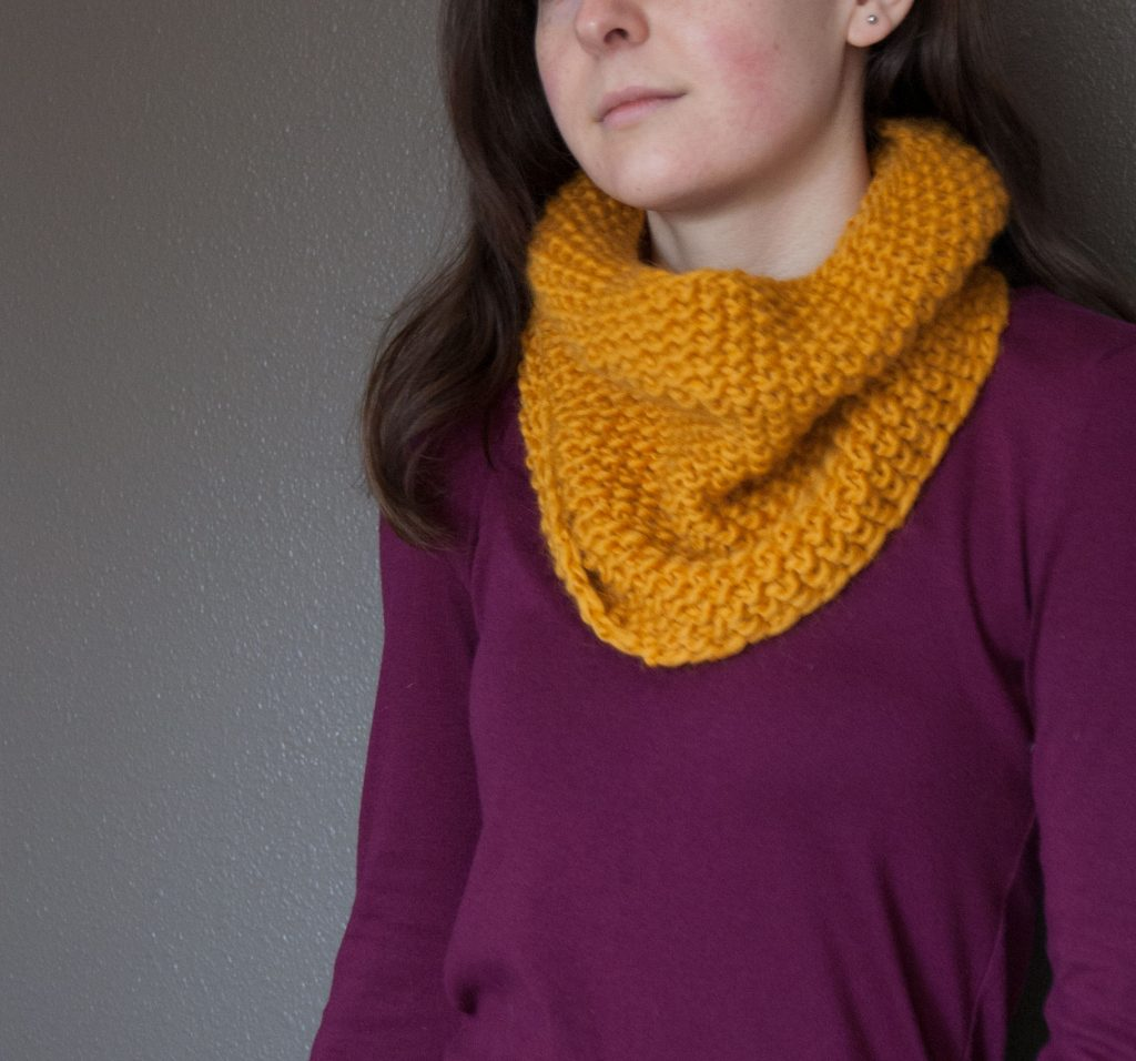 modeled seed stitch cowl in mustard yarn