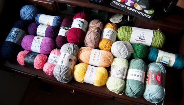 Desk full of popular acrylic yarns