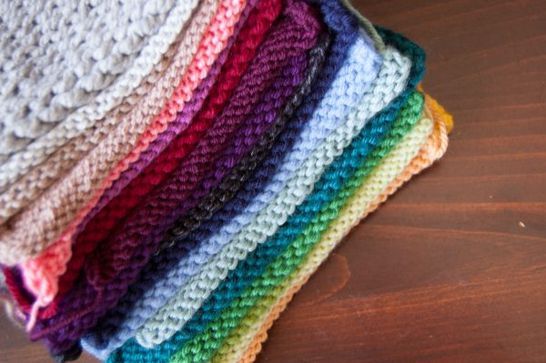 knit swatches of acrylic yarns in rainbow color