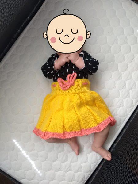baby wearing knit skirt soaker